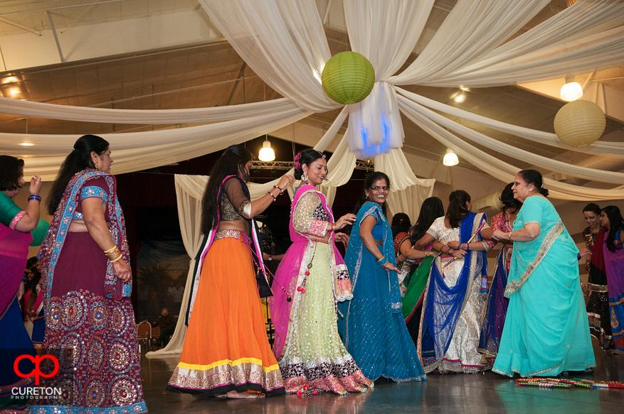 Indian family dancing traditional garba dancing.