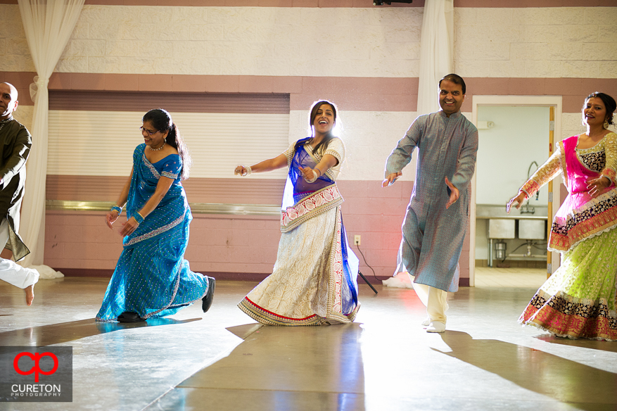 Indian family do traditional garb dance.