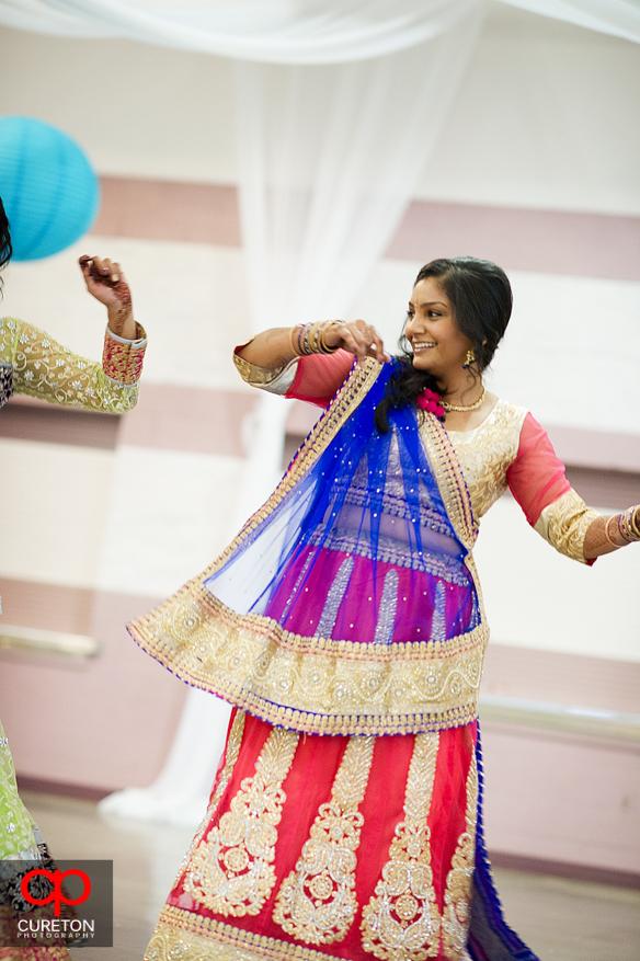 Bride dancing at Garba party.