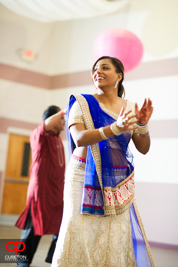Bride's sister dancing at the Garba party in Greenville.