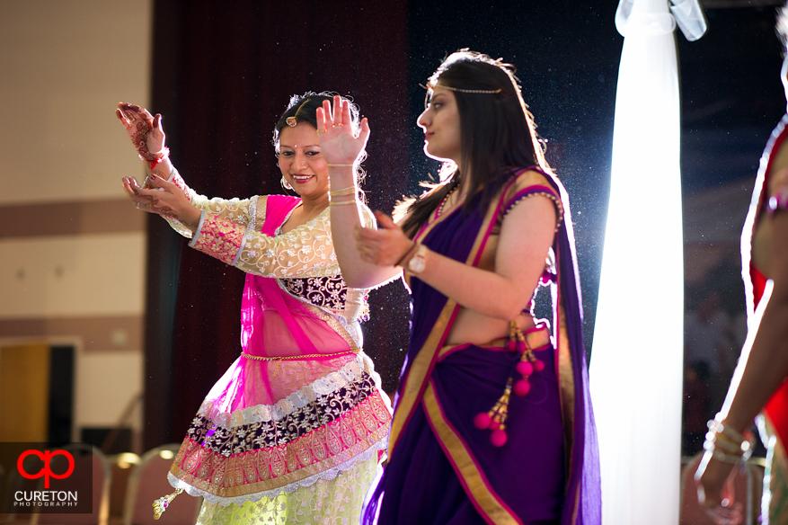 Indian women dancing.