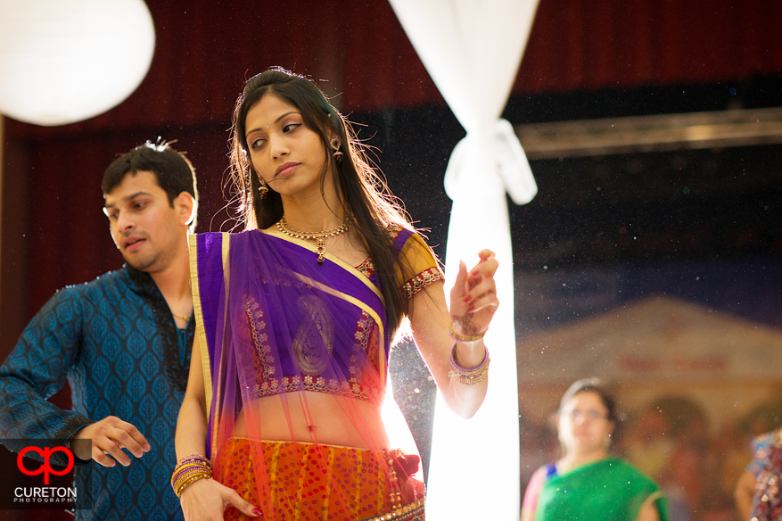 Indian woman in traditional dress dancing.