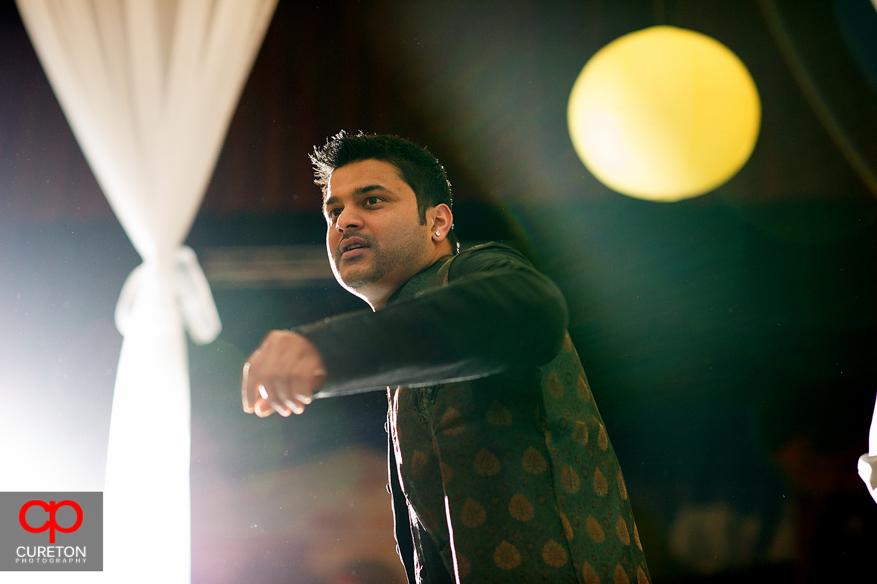 Indian man dancing at Garba.
