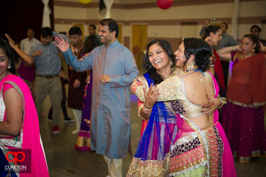 Bride and family dancing at Garba.