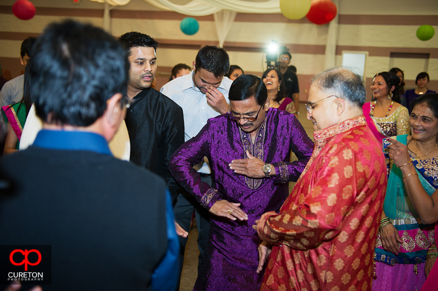 Bride's father dancing at the Garba.