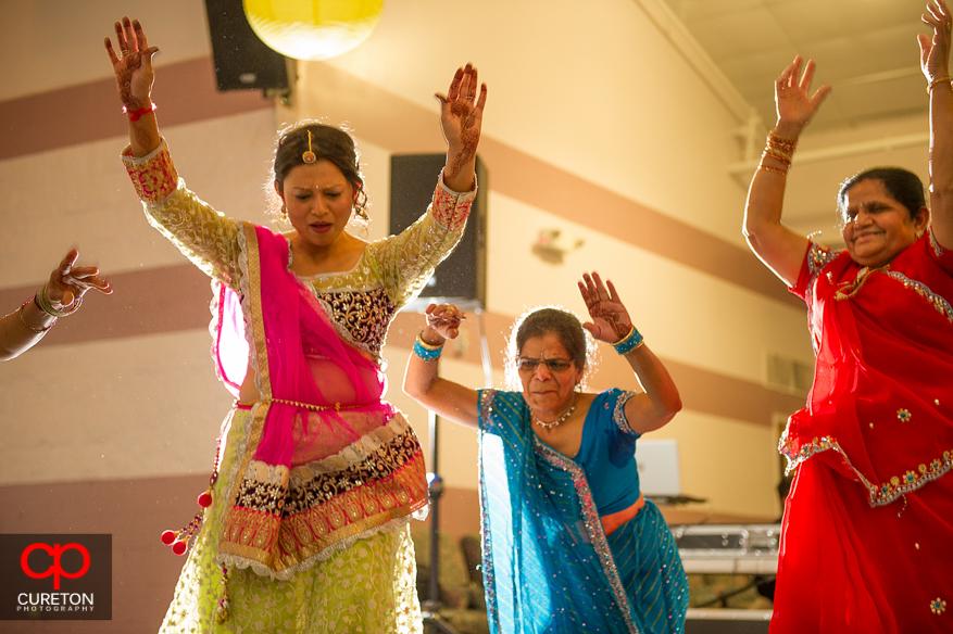 Bridesmaid and family dancing.