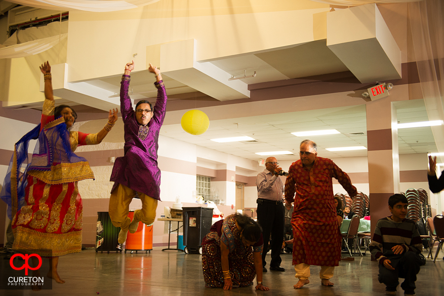 Father of the bride jumping in the air dancing at the Garba.