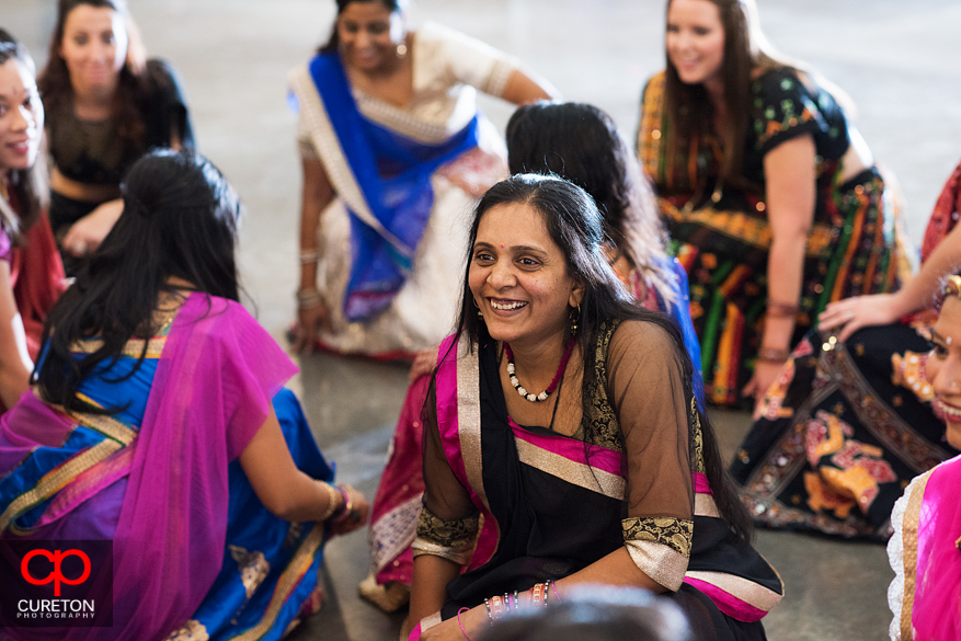 Indian woman sitting down at the Garba.