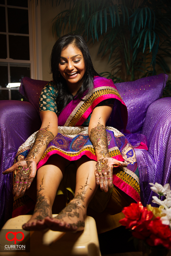 Indian bride with mehndi on her hands and feet during her party in Greenville,SC.