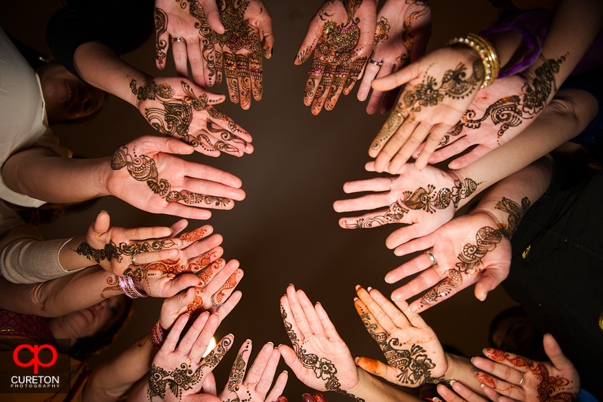 Bride and Bridesmaids henna covered hands.