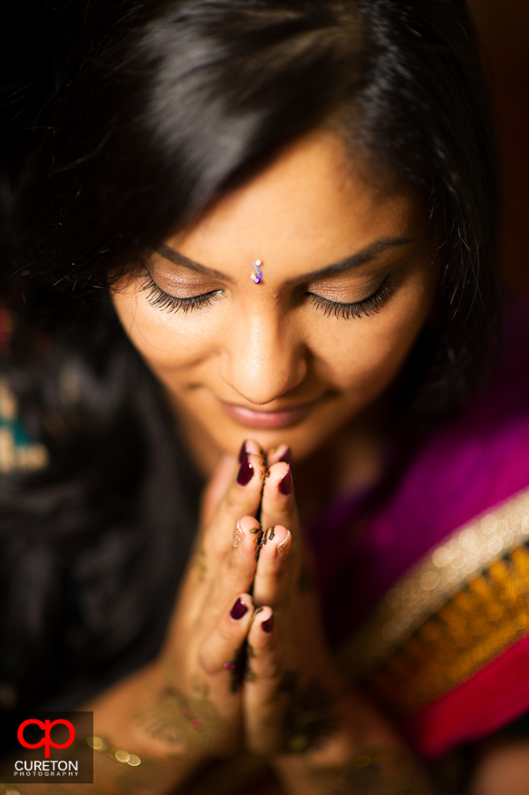 Closeup of bride during her mehndi party in Greenville,SC before her wedding.