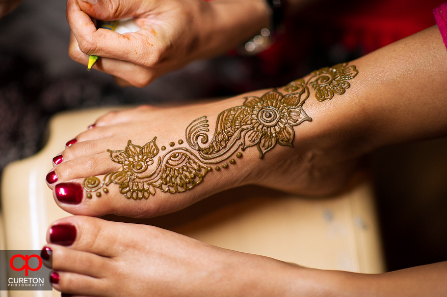 The henna being applied to the bride's feet.