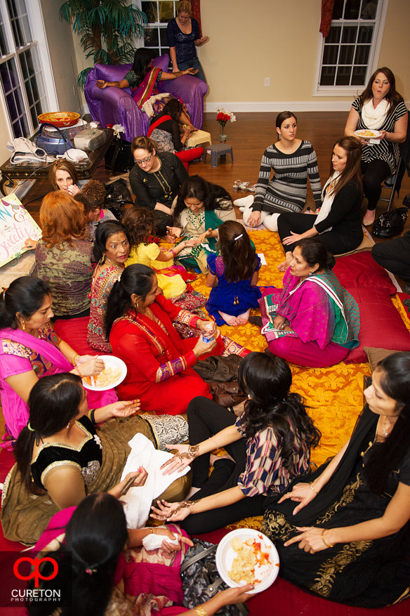 Guest gather at a Mehndi party in Greenville.
