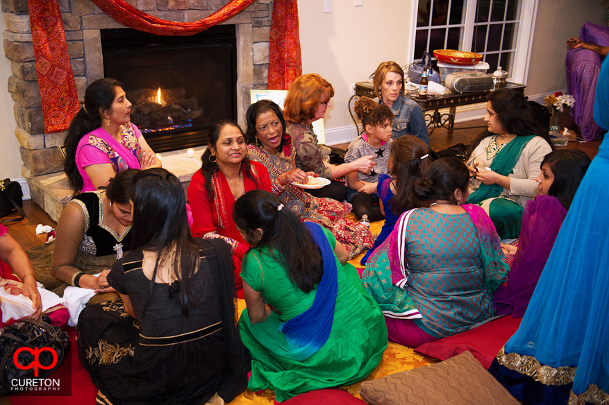 Family of the bride getting henna applied at a Mehndi.