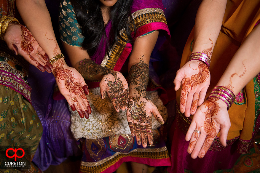 Close up of henna covered hands.