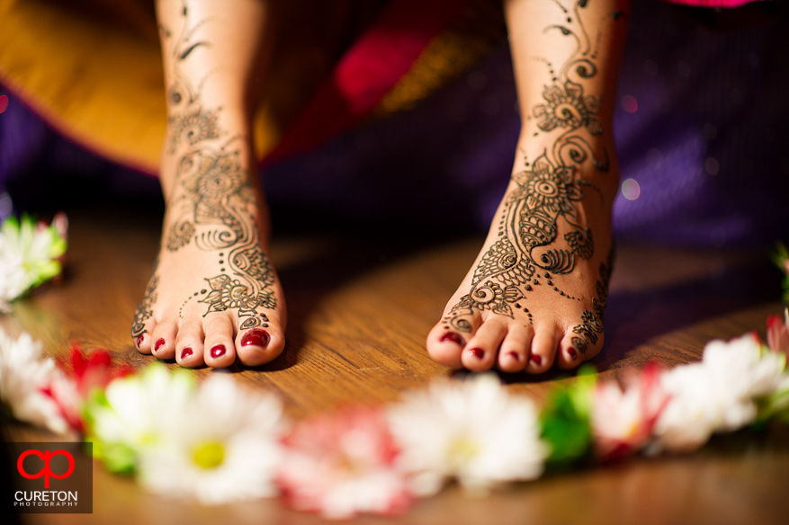 The brides mehndi covered feet and flowers.