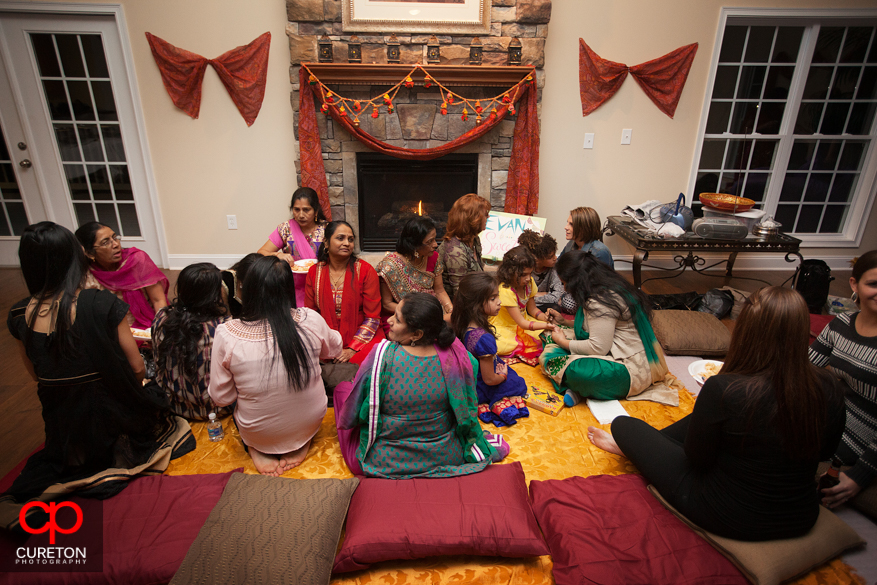 Indian women sitting during the Mahndi.