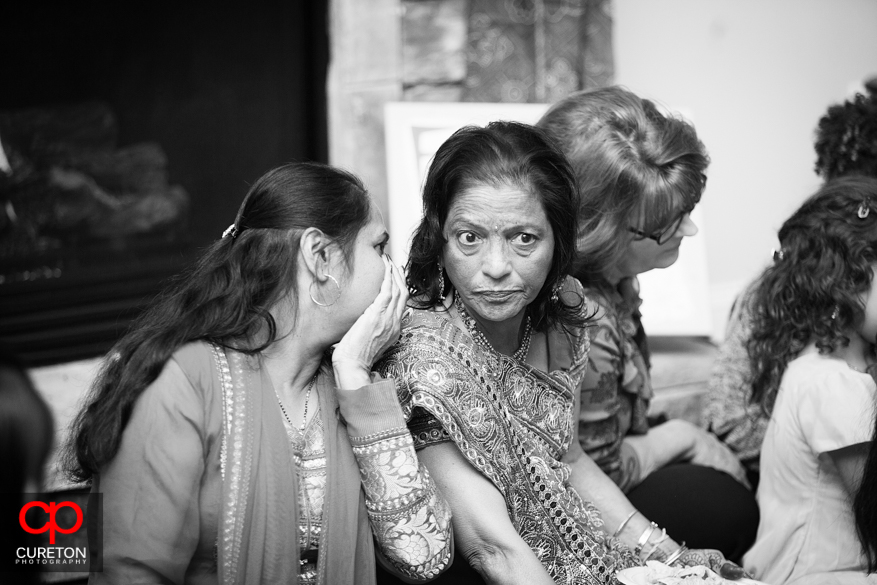 The bride's mother talking with guests.