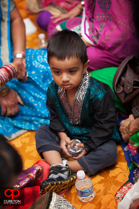 A boy watches the festivities at the party.