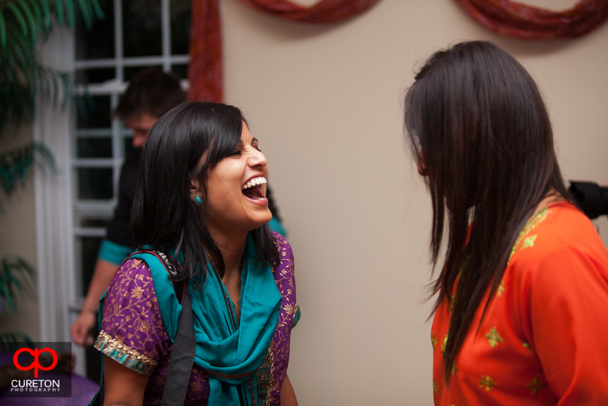 Guest laughing at the Mehndi.