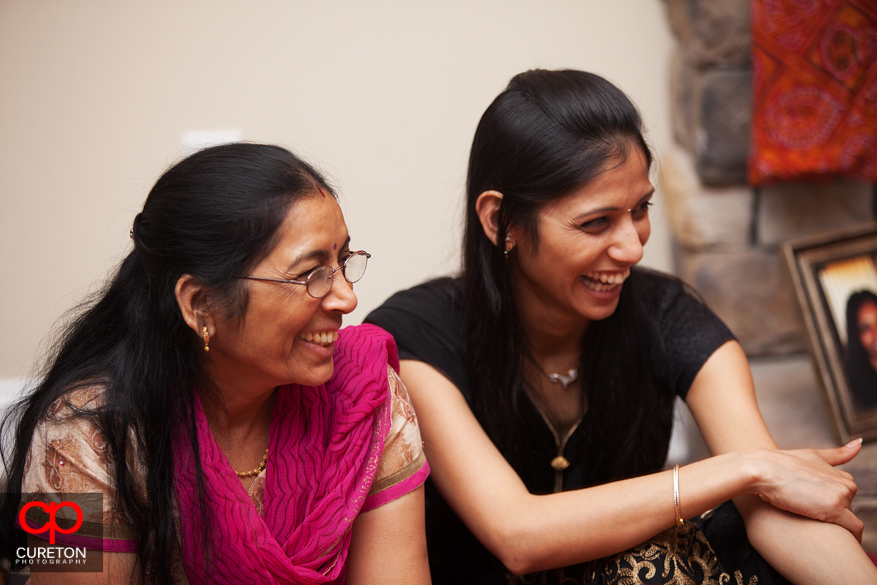 Women laughing having fun at the party.
