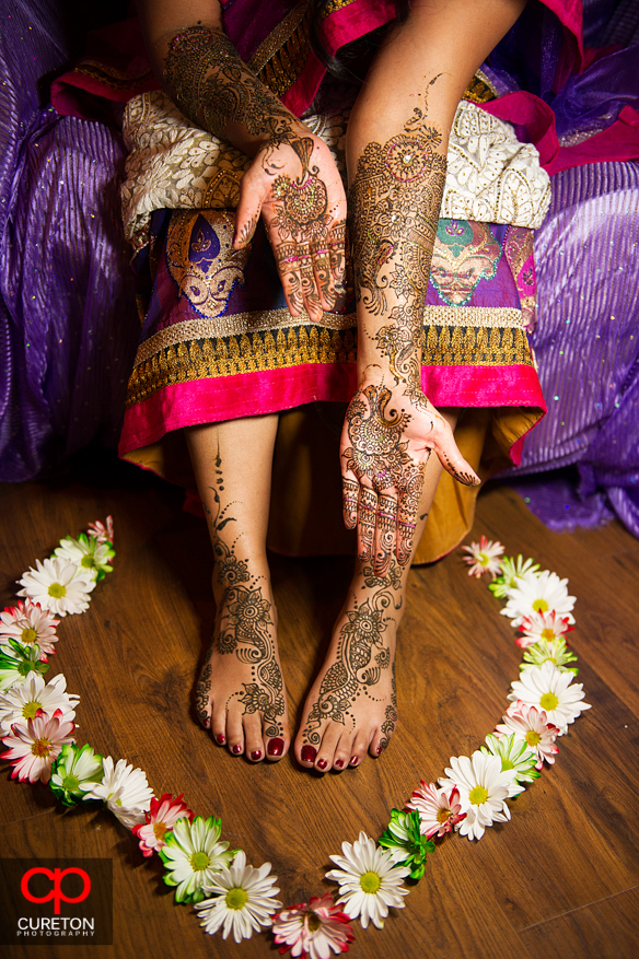 Closeup of brides hands, feet , and flowers during her mehndi party in Greenville,SC..
