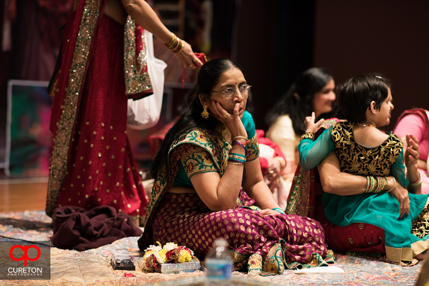 Indian women in deep thought during the ceremony.