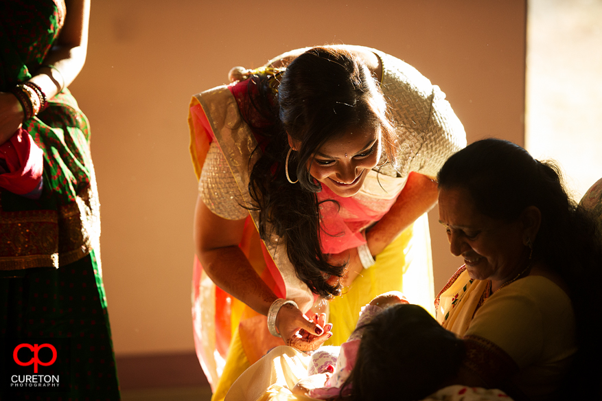 Indian bride looks at a child at her vidhi.