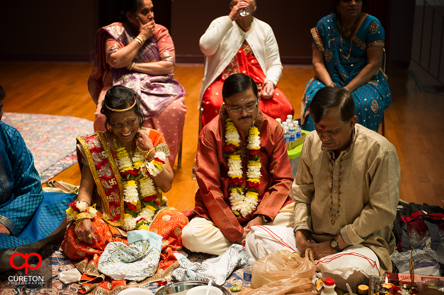The brides parents during her vidhi ceremony before an Indian wedding.