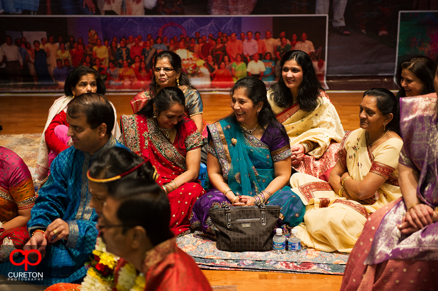 Indian women participating in the vidhi ceremony.