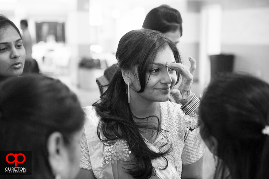 An Indian bride prepares for her vidhi before her wedding,.