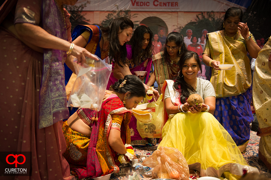 The bride walks onto the stage at the Vedic Center.