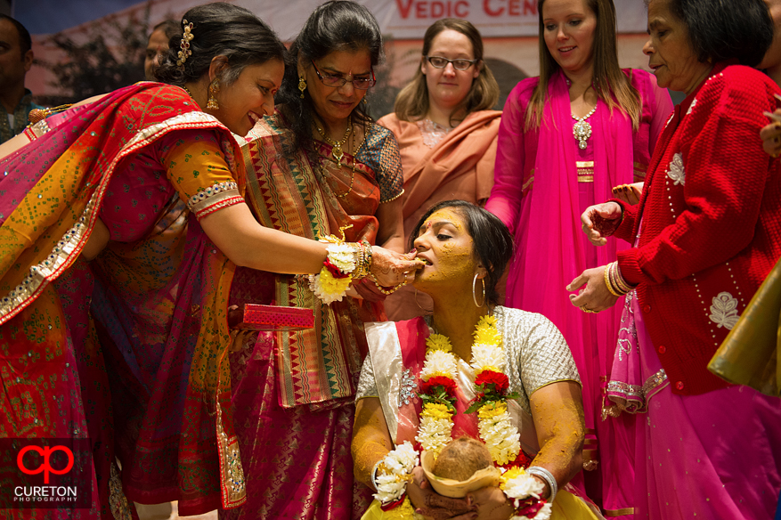 The bride is fed from her family during a traditional vidhi ceremony.