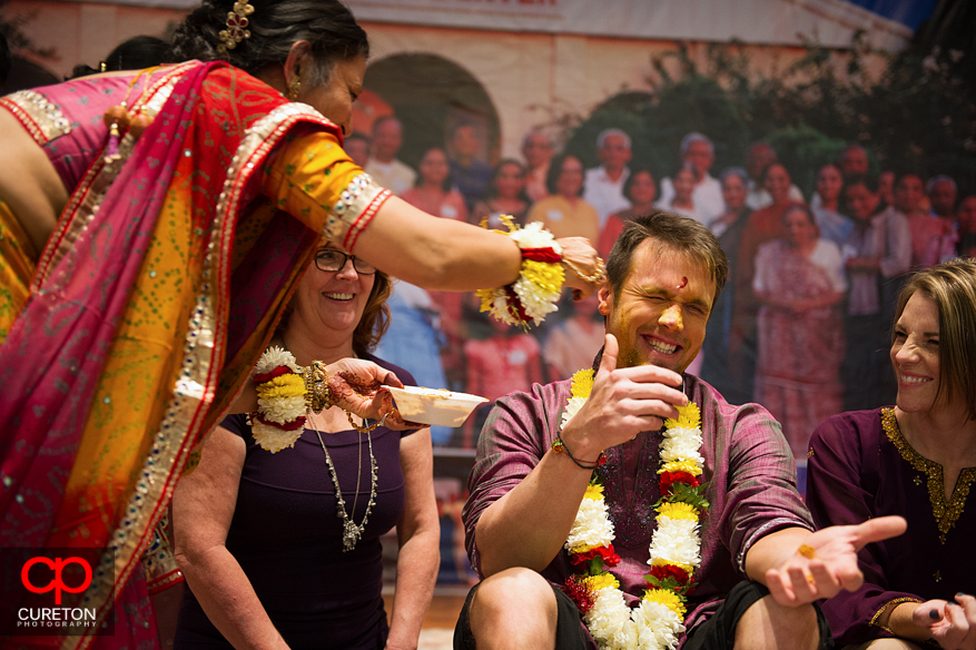 The groom has turmeric paste applied to his face.