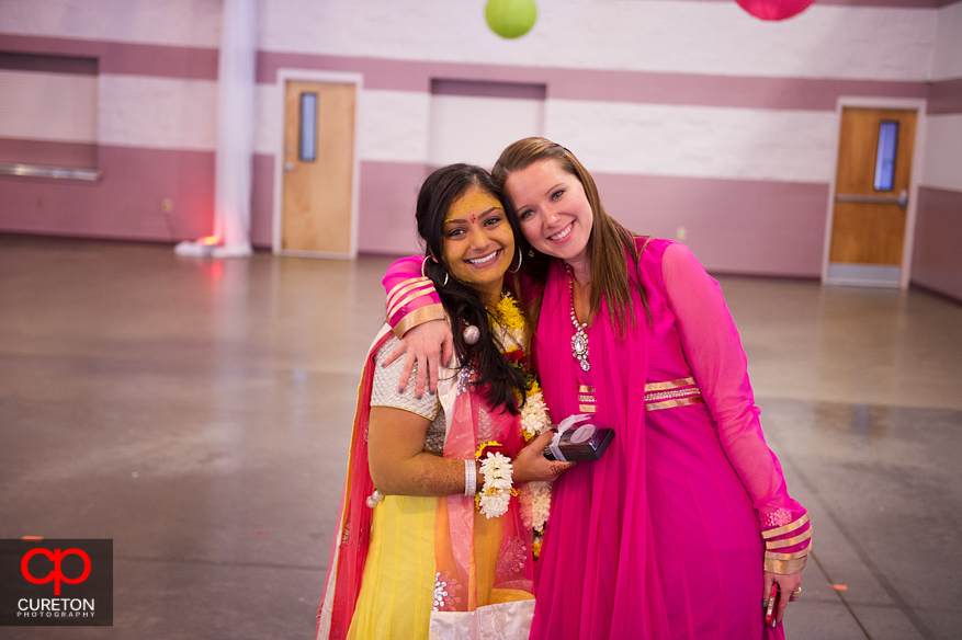 An Indian bride posing with her bridesmaid.