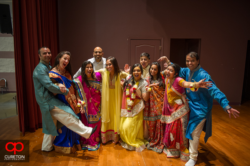 An Indian Bride poses with her family.