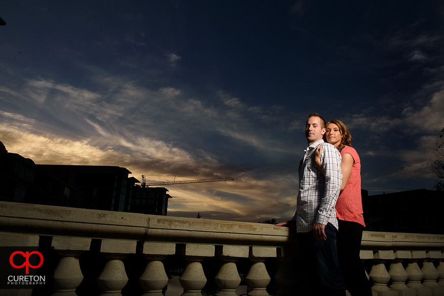 Engaged couple at sunset in downtown Greenville,SC.