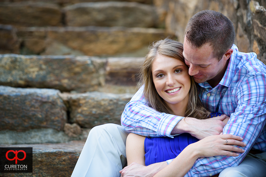 Couple hugging in Falls Park during their engagement session.
