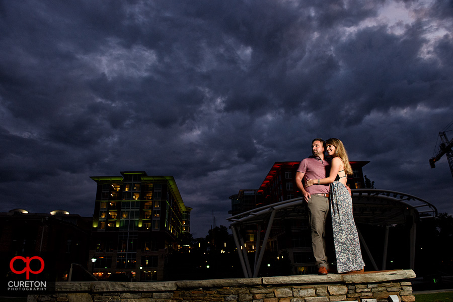 Couple at sunset unser epic downtown Greenville,SC sky.