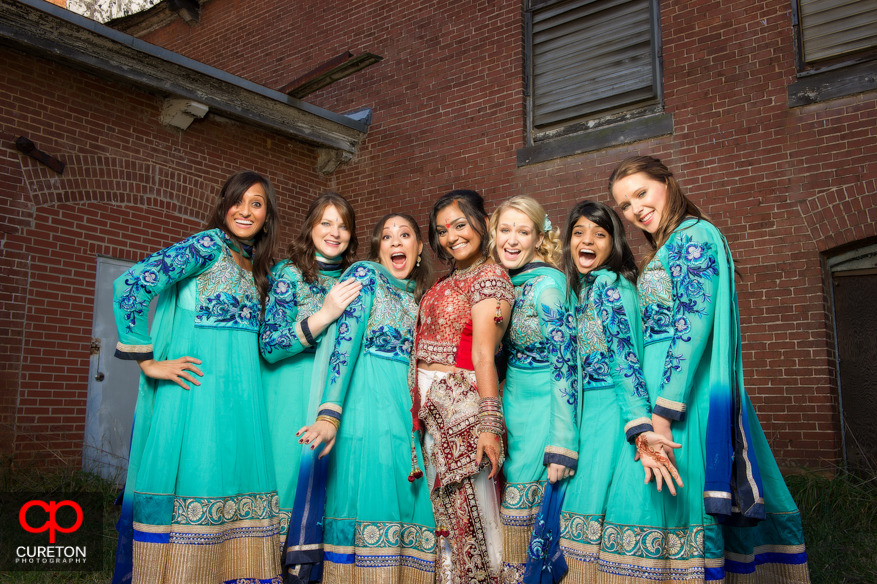Bride and Bridesmaids in full Indian dresses.