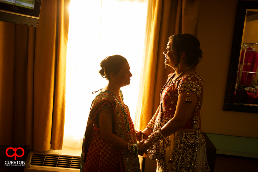 Indian bride and her mother share a moment in gorgeous light before her Indian wedding in Greenville,SC.