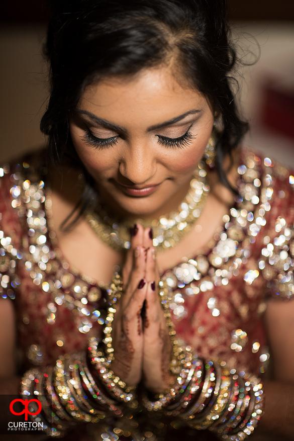 Indian bride praying.