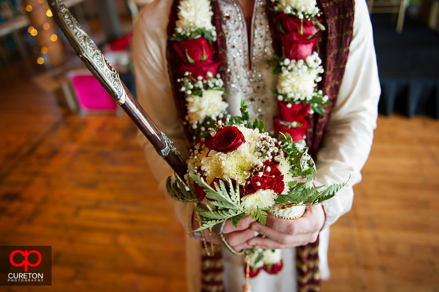 Groom with sword before his processional.