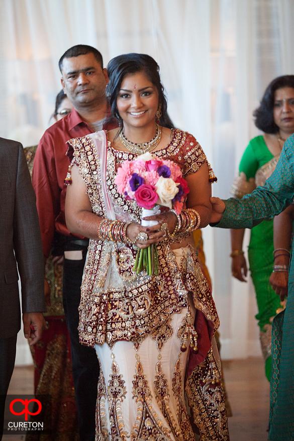 Beautiful Indian bride walks down the aisle.