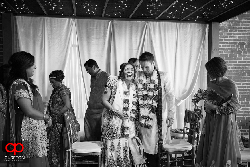 Bride and groom share a laugh during their ceremony.