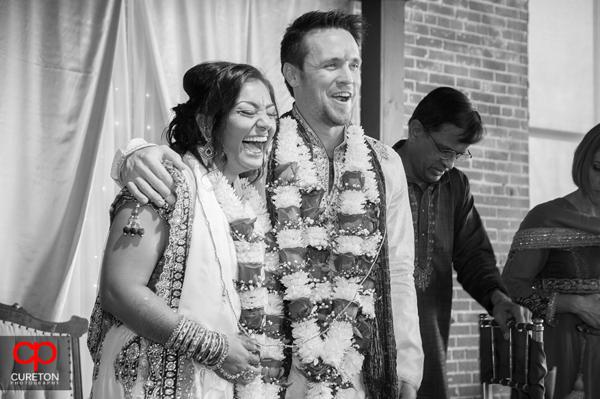 Bride and groom share a laugh during the ceremony.