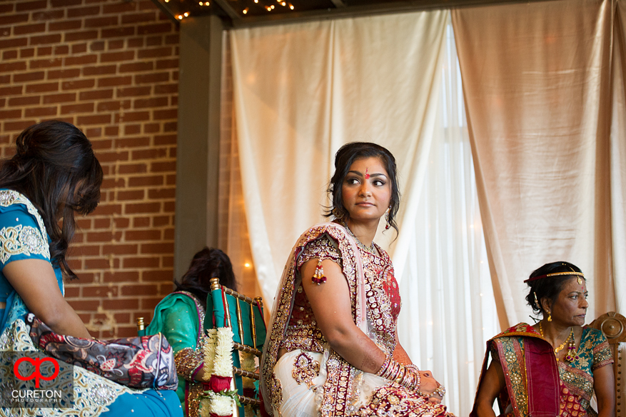 Indian bride looks away during the ceremony.