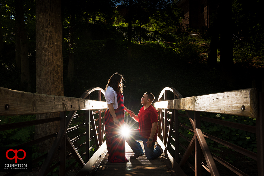 Man proposing to his girlfriend on the bridge at Falls Park in Greenville, SC.