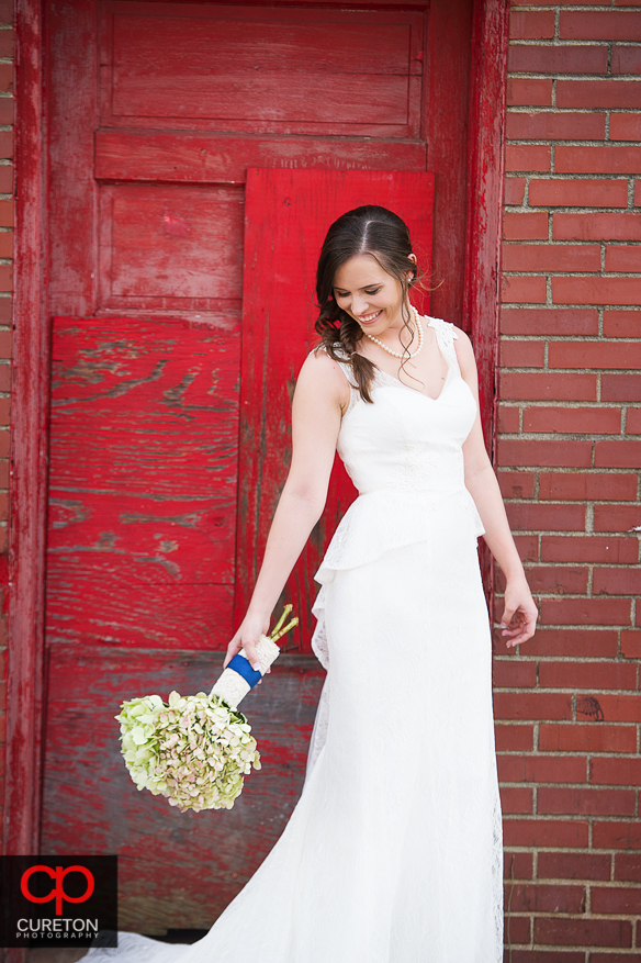 Smiling bride with flowers.