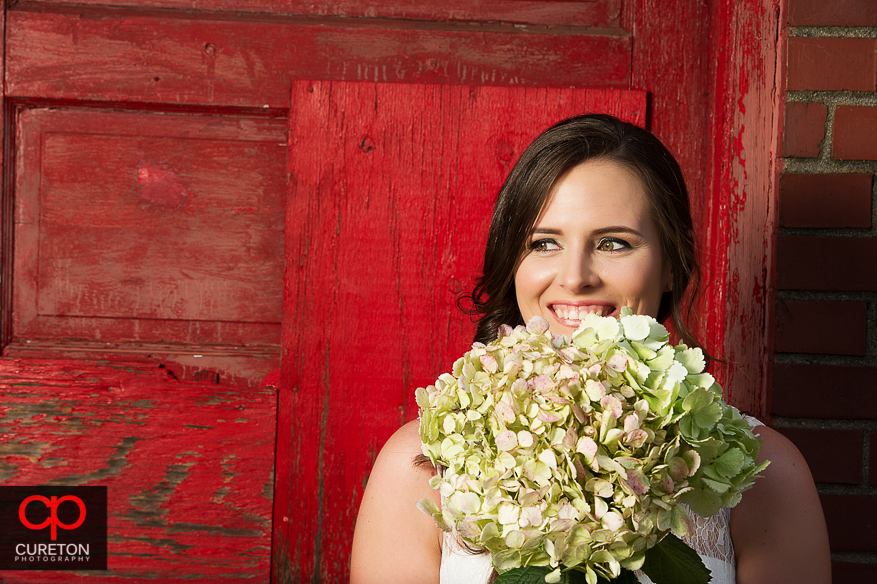 Bride with flowers close up.